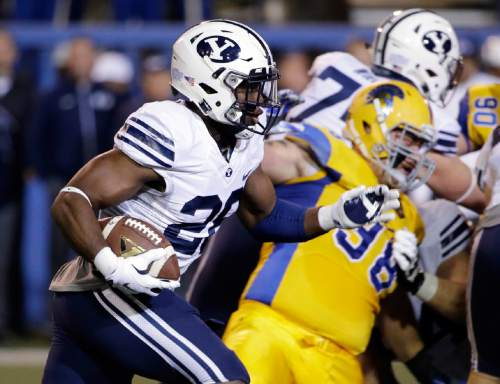 BYU running back Adam Hine (28) carries the ball against San Jose State  during the first half of an NCAA college football game Friday, Nov. 6, 2015, in San Jose, Calif. (AP Photo/Marcio Jose Sanchez)