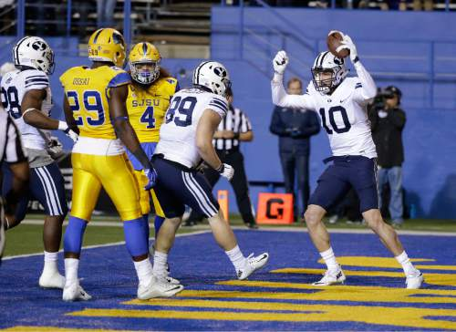 BYU's Mitch Mathews (10) celebrates his touchdown against San Jose State during the first half of an NCAA college football game Friday, Nov. 6, 2015, in San Jose, Calif. (AP Photo/Marcio Jose Sanchez)