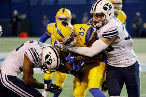 San Jose State wide receiver Hansell Wilson (87) is tackled by BYU defensive back Michael Wadsworth, right, during the first half of an NCAA college football game Friday, Nov. 6, 2015, in San Jose, Calif. (AP Photo/Marcio Jose Sanchez)
