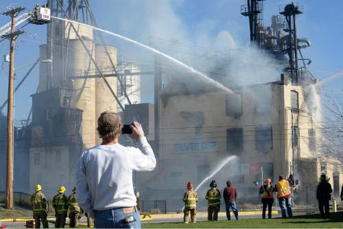 Scott Sommerdorf   |  The Salt Lake Tribune Firefighters battle a two-alarm fire at the iconic Silver Cup fish feed factory in Murray on Saturday.