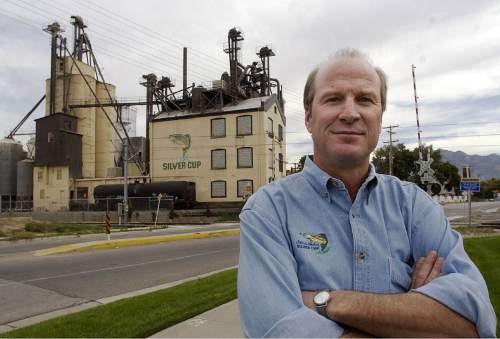 Steve Griffin  |  Tribune File Photo  Chris Nelson is the president of Nelson & Sons which is a Murray based company the makes fish food under the label Silver Cup Fish Feed. Here he stands outside their Murray plant. Sept. 19, 2003
