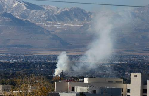 Scott Sommerdorf   |  The Salt Lake Tribune As seen from Millcreek, the two-alarm fire at the iconic Silver Cup fish feed factory in Murray, Saturday, November 7, 2015.