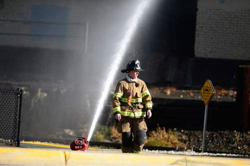 Scott Sommerdorf   |  The Salt Lake Tribune Firefighters battle a two-alarm fire at the iconic Silver Cup fish feed factory in Murray, Saturday, November 7, 2015.