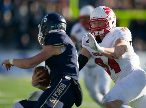 In this photo provided by Montana State University, Montana State quarterback Dakotah Prukop (5) attempts to elude Southern Utah linebacker Taylor Nelson (9) during the first half of an NCAA football game, Saturday, Nov. 7, 2015 in Bozeman, Mont. (Kelly Gorham/Montana State University via AP)