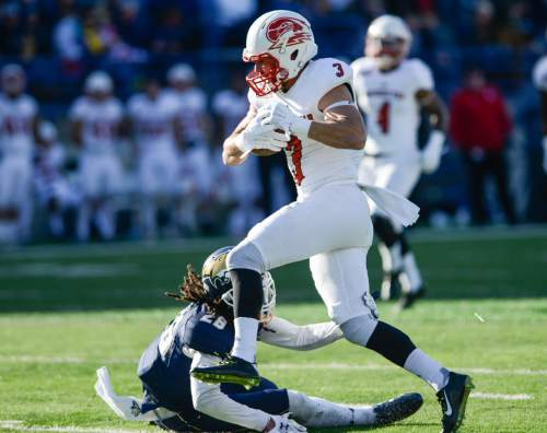Southern Utah wide receiver Justin Brown runs the ball against Montana State defensive back Tre'von Strong during the first half of an NCAA college football game on Saturday, Nov. 7, 2015, in Bozeman, Mont. (Adrian Sanchez-Gonzalez/Bozeman Daily Chronicle via AP)