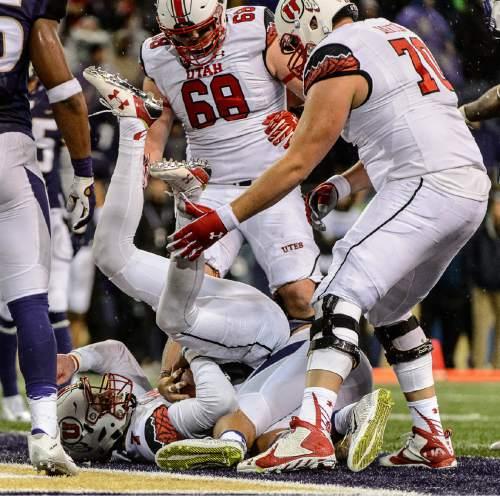 Trent Nelson  |  The Salt Lake Tribune Utah Utes quarterback Travis Wilson (7) scores a touchdown in the fourth quarter as the University of Utah faces the University of Washington, NCAA football at Husky Stadium in Seattle, Saturday November 7, 2015.