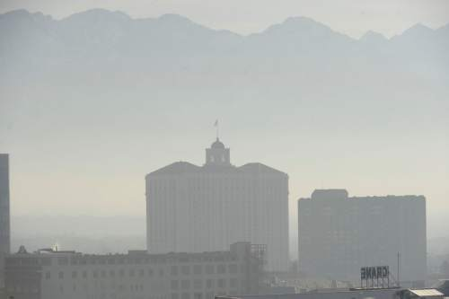 Al Hartmann  |  The Salt Lake Tribune View from the Gateway looking southeast to the Grand America Hotel.  Air pollution, (pm 2.5) begins building up in downtown Salt Lake City Tuesday Jan. 6.  It looks worse than it is.  The Utah Department of Environmental Quality's measurement was about 20  for pm 2.5, putting it into the yellow mandatory action range.  Stay tuned for more of the same for the next few days.