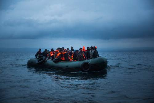 Refugees and migrants on a dinghy approach the northeastern Greek island of Lesbos after traveling from the Turkish coast, Thursday, Oct. 22, 2015. Greece is the main entry point for those fleeing violence at home and seeking a better life in the European Union. More than 500,000 people have arrived so far this year on Greece's eastern islands, paying smugglers to ferry them across from nearby Turkey. (AP Photo/Santi Palacios) Date : October 22, 2015