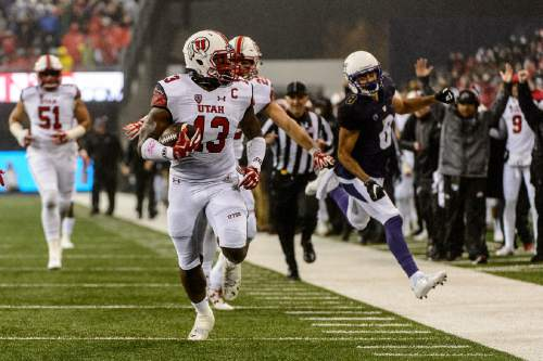 Trent Nelson  |  The Salt Lake Tribune Utah Utes linebacker Gionni Paul (13) runs for a touchdown as the University of Utah faces the University of Washington, NCAA football at Husky Stadium in Seattle, Saturday November 7, 2015.