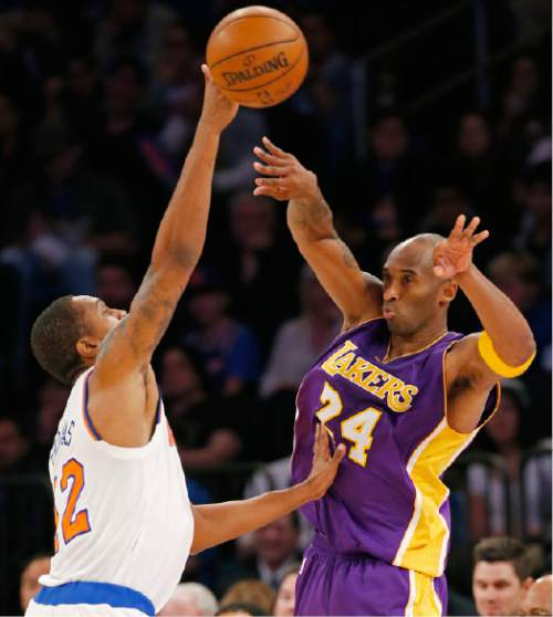ea424bf352a Los Angeles Lakers forward Kobe Bryant (24) passes around New York Knicks  forward Lance