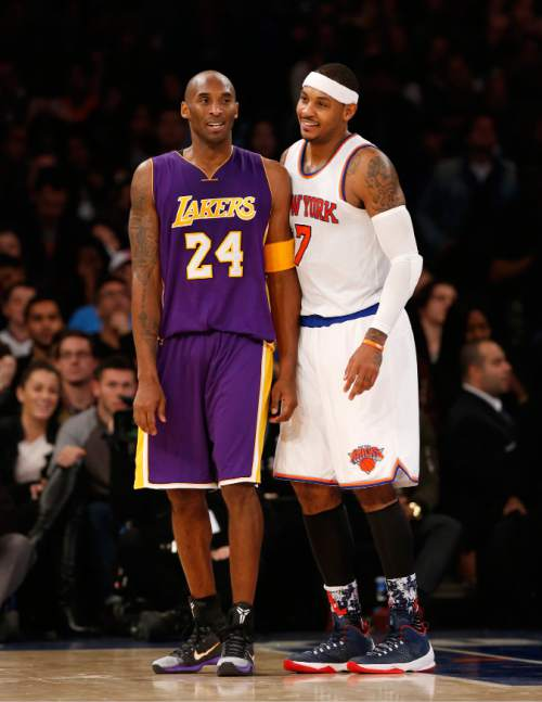 7816bd188ee Los Angeles Lakers forward Kobe Bryant (24) chats with New York Knicks  forward Carmelo