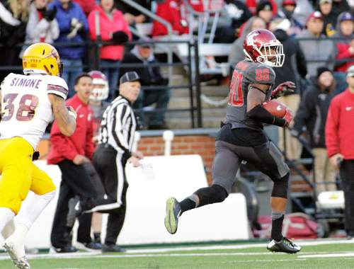 Washington State wide receiver Dom Williams (80) looks back as he pursued by Arizona State defensive back Jordan Simone (38) while running for a touchdown during the second half of an NCAA college football game, Saturday, Nov. 7, 2015, in Pullman, Wash. Washington State won 38-24. (AP Photo/Young Kwak)