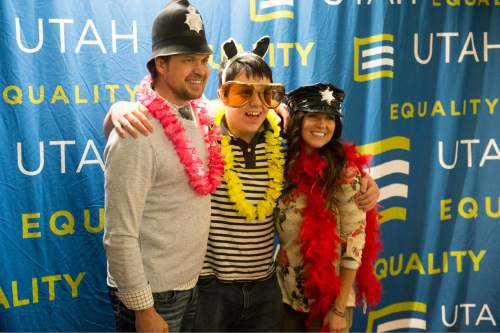 Rick Egan  |  The Salt Lake Tribune  John Andrew and Amy McLay pose for a family photo at the photo booth, during the Family Homo Evening, an event to celebrate all families, sponsored by Equality Utah and the Utah Pride Center, at the Impact Hub, Monday, November 9, 2015.