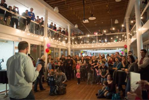 Rick Egan  |  The Salt Lake Tribune  Weston Clark speaks to an over-flow crowd during the Family Homo Evening to celebrate all families, sponsored by Equality Utah and the Utah Pride Center, at the Impact Hub, Monday, November 9, 2015.