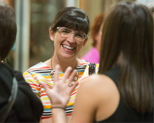Rick Egan  |  The Salt Lake Tribune  Kate Kelly shares a laugh with friends at the Family Homo Evening to celebrate all families, sponsored by Equality Utah and the Utah Pride Center, at the Impact Hub, Monday, November 9, 2015.