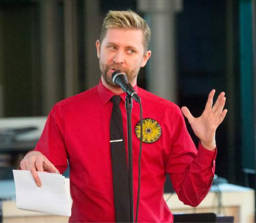 Rick Egan  |  The Salt Lake Tribune  Troy Williams speaks to an over-flow crowd during the Family Homo Evening to celebrate all families, sponsored by Equality Utah and the Utah Pride Center, at the Impact Hub, Monday, November 9, 2015.