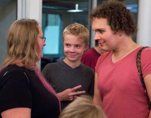 Rick Egan  |  The Salt Lake Tribune  Left to right, Sara, Xander and Addison Hemmert, spend time with their family at Family Homo Evening, at event to celebrate all families, sponsored by Equality Utah and the Utah Pride Center, at the Impact Hub, Monday, November 9, 2015.
