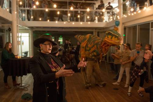 Rick Egan  |  The Salt Lake Tribune  Dr Sharon Griffith shares the dance floor with a giant dinosaur, as she dances to the sounds of The Mark Chaney Trio at Family Homo Evening, at event to celebrate all families, sponsored by Equality Utah and the Utah Pride Center, at the Impact Hub, Monday, November 9, 2015.