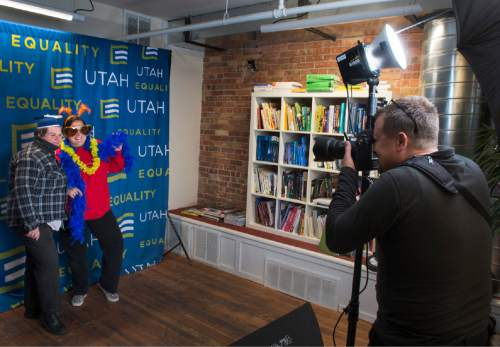 Rick Egan  |  The Salt Lake Tribune  Photographer Alex Gallivan, snaps a photo of Sarah and Meagan Debruyn, in the photo booth, at Family Homo Evening, at event to celebrate all families, sponsored by Equality Utah and the Utah Pride Center, at the Impact Hub, Monday, November 9, 2015.