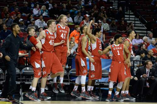 "Scott Sommerdorf   |  The Salt Lake Tribune The Utah bench including Utah Utes forward Jakob Poeltl (42) celebrates as Utah stretches it's lead late in the game. Utah defeated Georgetown 75-64 to advance to the ""Sweet Sixteen"", Saturday, March 21, 2015."