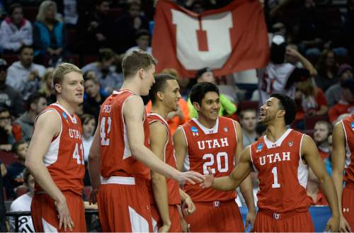 "Scott Sommerdorf   |  The Salt Lake Tribune Utah Utes guard Isaiah Wright (1), right, celebrates with Utah Utes forward Jakob Poeltl (42) and other team mates as Utah stretched it's lead to ten points late in the game. Utah defeated Georgetown 75-64 to advance to the ""Sweet Sixteen"", Saturday, March 21, 2015."