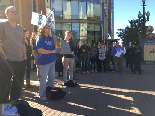 Courtesy     Mike Fessler, KUTV  Dozens of people gathered Sunday to protest the new LDS Church policy regarding gay couples and their children.