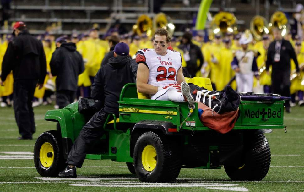 Utah's Chase Hansen is taken off the field on a cart after suffering an injury on the final play of an NCAA college football game against Washington, Saturday, Nov. 7, 2015, in Seattle. Utah beat Washington 34-23. (AP Photo/Ted S. Warren)