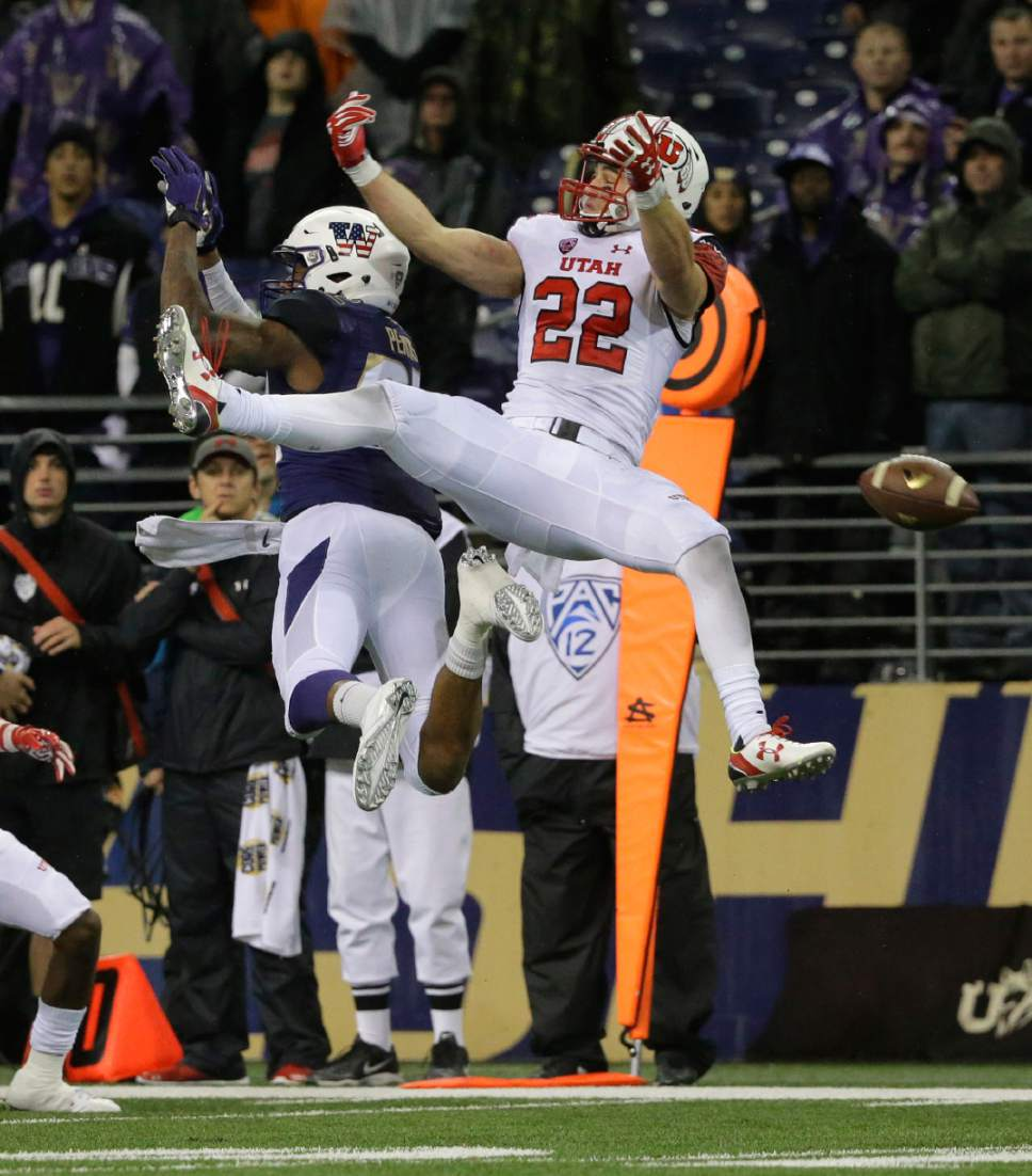Utah defensive back Chase Hansen (22) breaks up a pass intended for Washington tight end Joshua Perkins, left, during the second half of an NCAA college football game, Saturday, Nov. 7, 2015, in Seattle. Utah won 34-23. (AP Photo/Ted S. Warren)