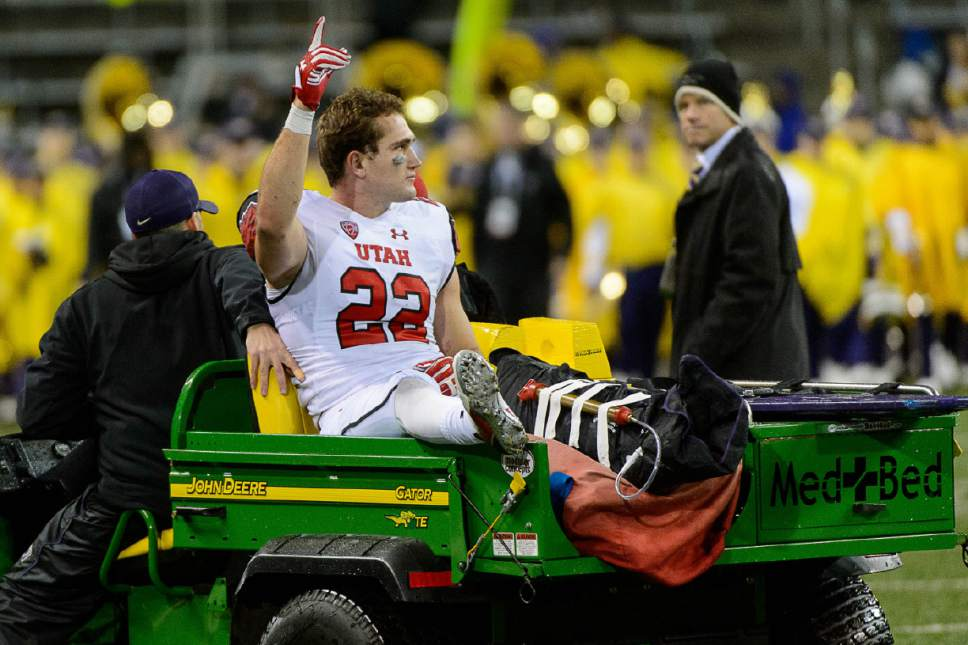 Trent Nelson  |  The Salt Lake Tribune Utah's Chase Hansen (22) is taken from the field following the game as the University of Utah faces the University of Washington, NCAA football at Husky Stadium in Seattle, Saturday November 7, 2015.