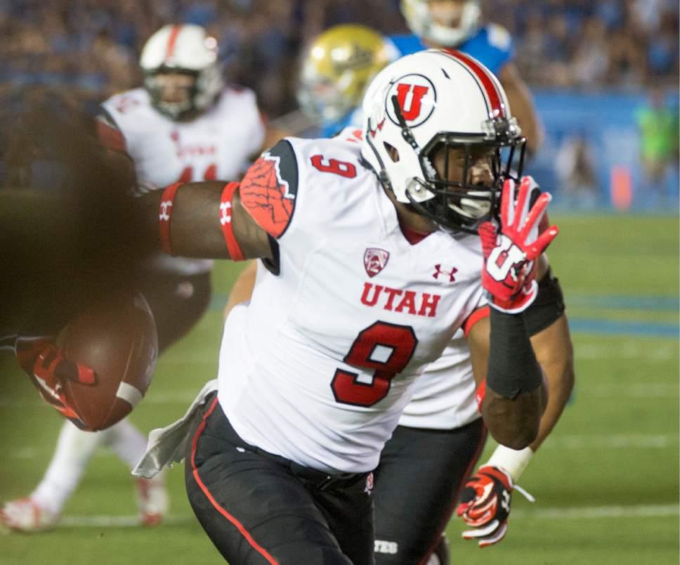 Rick Egan  |  The Salt Lake Tribune   Ute defensive back Tevin Carter (9) intercepts a UCLA pass and runs for a touchdown, as the Utah Utes  vs. UCLA Bruins, at the Rose Bowl in Pasadena, Saturday, October 4, 2014