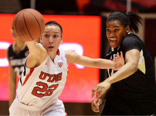Steve Griffin  |  The Salt Lake Tribune  Utah Utes guard Danielle Rodriguez (22) holds off Colorado Buffaloes guard Ashley Wilson (12) as she stretches for the ball during second half action in the Utah versus Colorado women's basketball game at the Huntsman Center in Salt Lake City, Utah Wednesday, January 29, 2014.