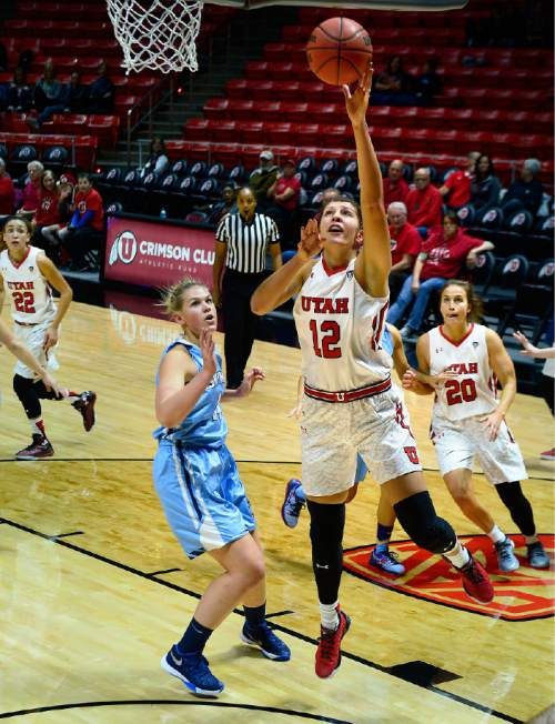 Scott Sommerdorf   |  The Salt Lake Tribune Utah F Emily Potter drives for a shot during first half play. Utah led Fort Lewis 46-32 at the half, Friday, November 6, 2015.