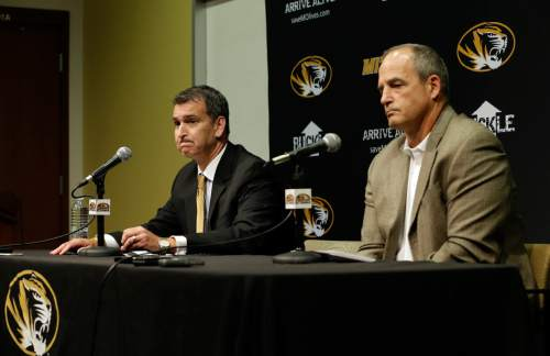Missouri Athletics Director Mack Rhoades, left, and head football coach Gary Pinkel address the media Monday, Nov. 9, 2015, in Columbia, Mo. Football will resume at Missouri following the resignation of University of Missouri system president Tim Wolfe after several members of the team, pointing to Wolfe's inaction in handling of racial tensions at the school, announced over the weekend that they would not play until the president was gone. (AP Photo/Jeff Roberson)