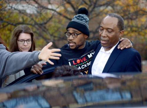 Jonathan Butler, center, enters a car as he leaves the University of Missouri campus Monday, Nov. 9, 2015, after he ended his hunger strike now that University of Missouri System President Tim Wolfe has officially resigned, in Columbia, Mo. Wolfe has been under fire for his handling of race complaints that had threatened to upend the football season and moved Butler to go on a hunger strike.  (Justin L. Stewart/Columbia Missourian via AP)
