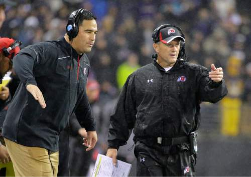 Utah head coach Kyle Whittingham, right, gestures from the sideline during the first half of an NCAA college football game against Washington, Saturday, Nov. 7, 2015, in Seattle. (AP Photo/Ted S. Warren)