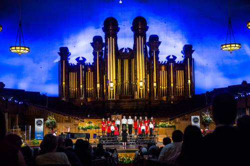 Chris Detrick  |  The Salt Lake Tribune Members of The Family Federation for World Peace and Unification Children's Choir perform during the annual Interfaith Musical Tribute at the Mormon Tabernacle Sunday March 22, 2015.  The Tribute originated the Sunday before the 2002 Winter Olympic Games as a time of prayerful reflection for religious leaders and others preparing to welcome the world to Salt Lake City. It returns every year on the anniversary of the Games and is the signature event of Interfaith Month in Utah.