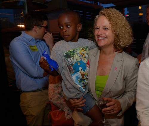 Leah Hogsten     The Salt Lake Tribune Jackie Biskupski and her son Archie, 5, celebrate the primary win, August 11, 2015 at Stoneground Kitchen. Former state legislator Jackie Biskupski and Salt Lake City Mayor Ralph Becker won Tuesday's primary race for the mayor's seat and will face off in the Nov. 3 general election.