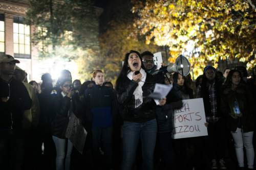 Michigan students stand in solidarity Wednesday, Nov. 11, 2015, with University of Missouri protesters and students, in Ann Arbor, Mich. A march and rally offered a show of support to University of Missouri students whose protests led two top administrators to resign. (Dominic Valente/The Ann Arbor News via AP)