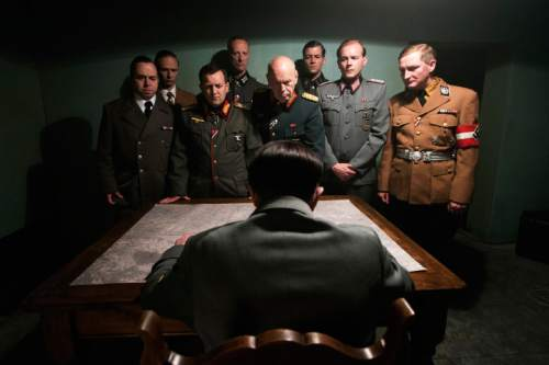 """This photo provided by the Smithsonian Channel shows, an actor portraying Adolf Hitler, seated, addressing his top generals in the new Smithsonian Channel special, """"The Day Hitler Died."""" The documentary premieres on the Smithsonian Channel on Monday, Nov. 16, 2015, at 8 p.m. EDT/PDT. (Smithsonian Channel via AP)"""