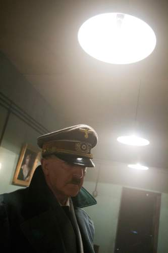 """This photo provided by the Smithsonian Channel shows an actor portraying Adolph Hitler, in a corridor in his bunker in the new Smithsonian Channel special, """"The Day Hitler Died."""" The documentary premieres on the Smithsonian Channel on Monday, Nov. 16, 2015, at 8 p.m. EDT/PDT. (Smithsonian Channel via AP)"""