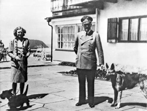 """FILE - This undated file photo shows Adolf Hitler, right, and his mistress Eva Braun posing on the Terrace of the Berghof, in Berchtesgeden, Germany. American television viewers get their first chance to see and hear Hitler's inner circle describe the dictator's final hours in filmed interviews when """"The Day Hitler Died"""" premieres on the Smithsonian Channel on Monday, Nov. 16, 2015, at 8 p.m. EDT/PDT. Hitler shot himself alongside Braun, the longtime mistress who took a poison capsule and died beside Hitler the day after they were married. (AP Photo, File)"""