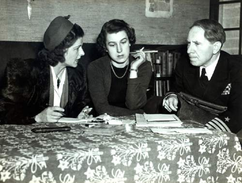 """This undated photograph provided by courtesy of Duquesne University/Musmanno Collection shows Trudl Junge, center, with Judge Michael Musmanno, right, and an unidentified interpreter included in the documentary film, """"The Day Hitler Died.""""  The film premieres on the Smithsonian Channel on Monday, Nov. 16, 2015, at 8 p.m. EDT/PDT. (Duquesne University/Musmanno Collection via AP)"""