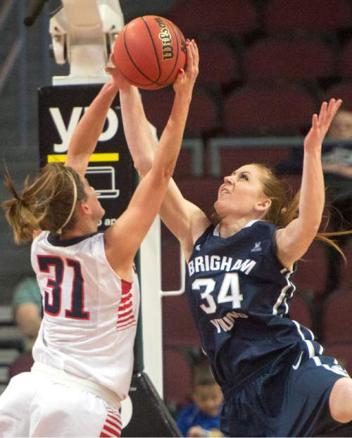 Rick Egan  |  The Salt Lake Tribune  Gonzaga Bulldogs guard Elle Tinkle (31) goes for a reboud along with Brigham Young Cougars forward Micaelee Orton (34), in the West Coast Conference Basketball Championships, at the Orleans Arena, in Las Vegas,  Monday, March 9, 2015
