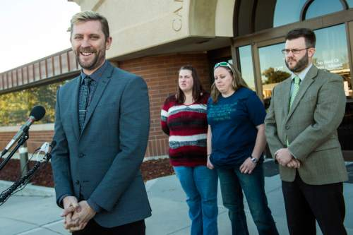 Chris Detrick  |  The Salt Lake Tribune Equality Utah Executive Director Troy Williams, April Hoagland, Beckie Peirce and attorney Jim Hunnicutt during a press conference outside of the Juvenile Court in Price, Utah Friday November 13, 2015. Seventh District Juvenile Judge Scott Johansen has amended an order to remove a 9-month-old girl from the Price home of her same-sex foster parents and has instead scheduled a hearing on the matter.