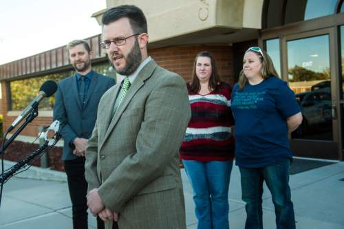 Chris Detrick  |  The Salt Lake Tribune Attorney Jim Hunnicutt, Equality Utah Executive Director Troy Williams, April Hoagland, Beckie Peirce during a press conference outside of the Juvenile Court in Price, Utah Friday November 13, 2015. Seventh District Juvenile Judge Scott Johansen has amended an order to remove a 9-month-old girl from the Price home of her same-sex foster parents and has instead scheduled a hearing on the matter.