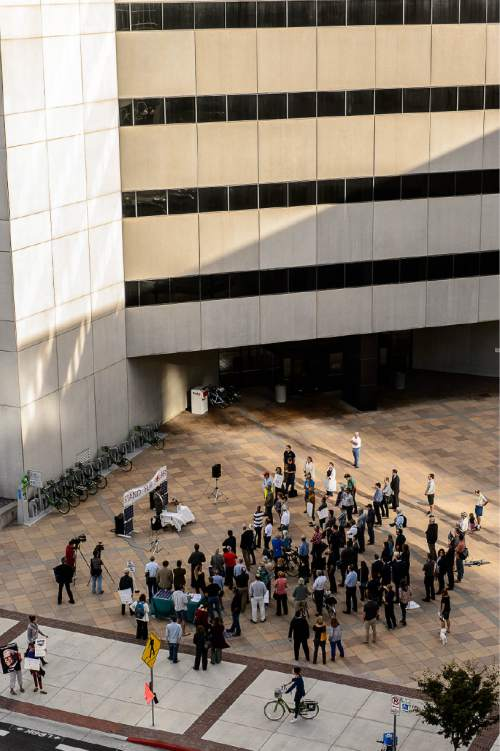 Trent Nelson  |  The Salt Lake Tribune Clean energy advocates gather outside the Utah Public Service Commission (PSC) in Salt Lake City, Thursday October 8, 2015, before a hearing on fees levied by utilities on rooftop solar users.