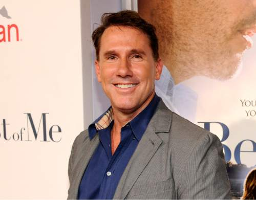 "FILE - In this Oct. 7, 2014 file photo, Nicholas Sparks poses at the premiere of the film ""The Best of Me"" at Regal Cinemas L.A. Live in Los Angeles.   (Photo by Chris Pizzello/Invision/AP, File)"