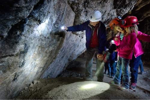 Scott Sommerdorf      The Salt Lake Tribune Hikers examine ancient cave art in Danger Cave near Wendover on Saturday.