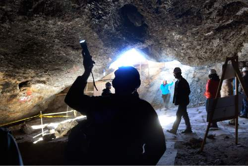 Scott Sommerdorf   |  The Salt Lake Tribune Hikers examine the ceiling inside Danger Cave near Wendover, Saturday, November 14, 2015.