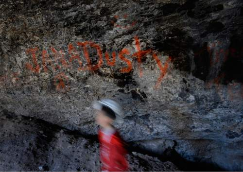 Scott Sommerdorf   |  The Salt Lake Tribune Unfortunate graffiti mars the interior of Danger Cave near Wendover, Saturday, November 14, 2015.